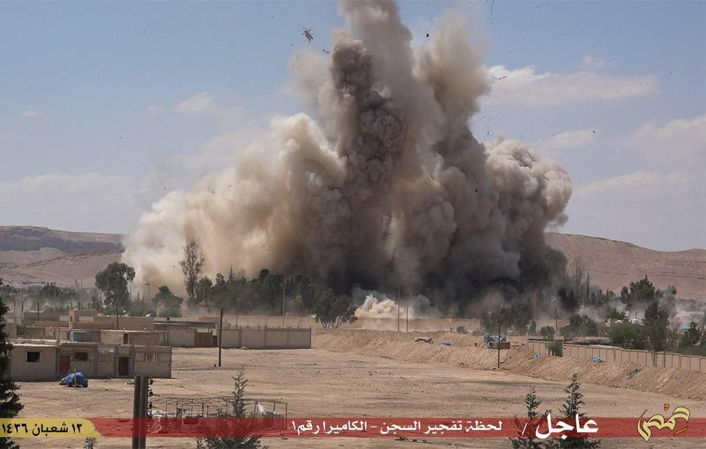 An image made available by Jihadist media outlet Welayat Homs on May 30, 2015, allegedly shows the Tadmur prison in the Syrian city of Palmyra being blown up by Islamic State group jihadists (AFP Photo/)