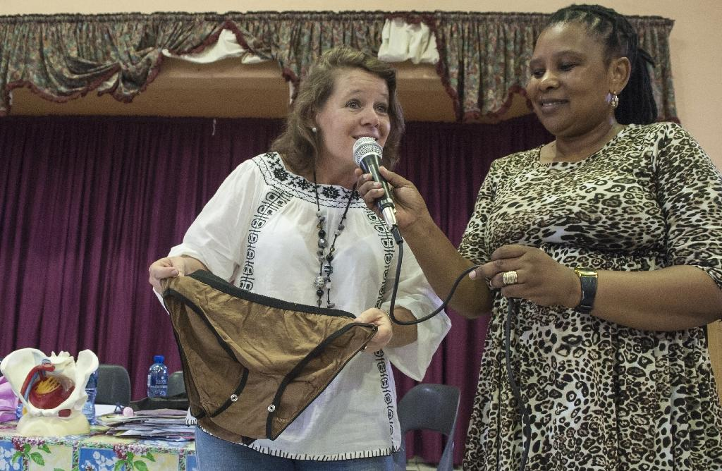 Sue Barnes, who designed a reusable pack of pads and panties, holds up one of the Subz panties during an educational talk about menstruation and female reproductive system at the Ekuthuleni Primary school in Durban on March 6, 2015 (AFP Photo/Stefan Heunis)