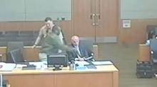 Man punches his own lawyer in court