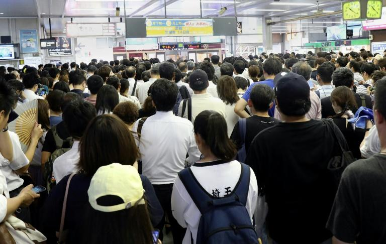 The powerful storm caused chaos for commuters (AFP Photo/JIJI PRESS)