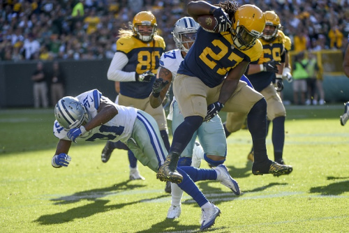 Oct 16, 2016; Green Bay, WI, USA; Green Bay Packers running back Eddie Lacy (27) jumps over Dallas Cowboys safety Byron Jones (31) in the first quarter at Lambeau Field. Mandatory Credit: Benny Sieu-USA TODAY Sports