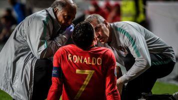 Ronaldo injured inEuro qualifying game vs. Serbia