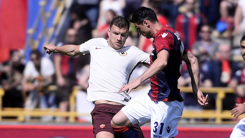 Bologna 0 Roma 3: Dzeko helps keep Juventus in sight