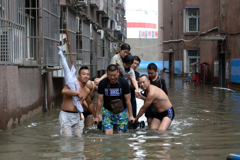 Flooding is not uncommon during the summer monsoon season in northern China, but showers have been unusually heavy across the country this summer