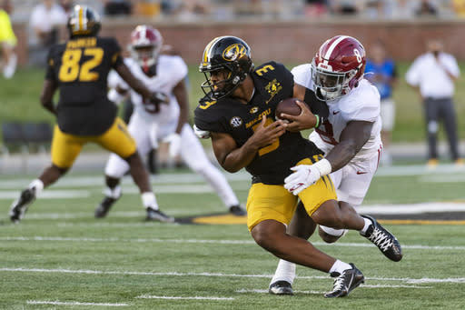 Missouri starting quarterback Shawn Robinson, left, is sacked by Alabama's Christian Harris, right, during the first quarter of an NCAA college football game Saturday, Sept. 26, 2020, in Columbia, Mo. (AP Photo/L.G. Patterson)