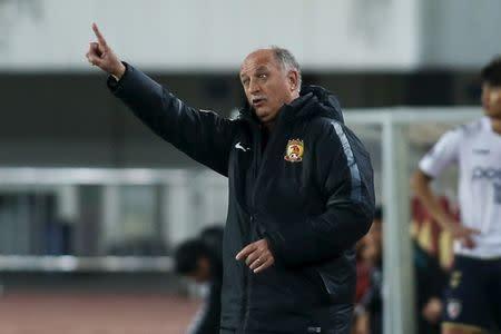 Head coach Luiz Felipe Scolari of Guangzhou Evergrande gestures during AFC Champions League Group H match in Guangzhou
