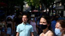 As cases soar, Spaniards keep their masks firmly on