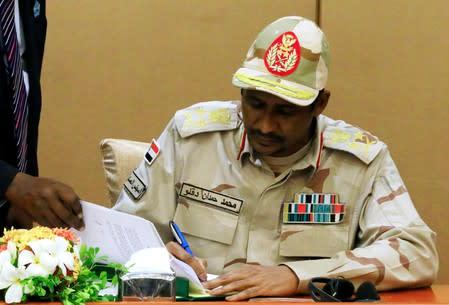 Deputy Head of Sudanese Transitional Military Council, Mohamed Hamdan Dagalo signs a constitutional declaration in Khartoum