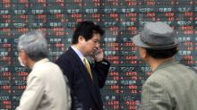 Asian Equities Edge Lower as China Reports Weak Industrial Output Data