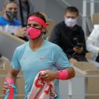 The Latest: Defending champion Nadal reaches 3rd round