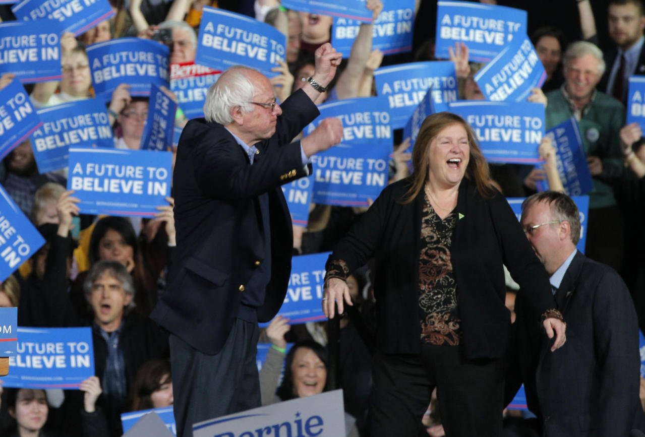 <p>Democratic U.S. presidential candidate U.S. Sen. Bernie Sanders pumps his fists as he arrives with his wife, Jane, and son Levi, right, at his Super Tuesday rally in Burlington, Vt. <i>(Photo: Brian Snyder/Reuters)</i></p>