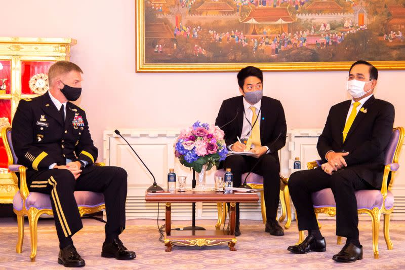 U.S. Army Chief of Staff General McConville and Thailand's PM Prayuth Chan-ocha pose during their meeting at Government House in Bangkok