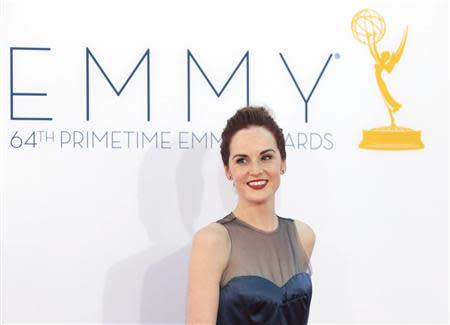 """British actress Michelle Dockery of the drama series """"Downton Abbey"""" arrives at the 64th Primetime Emmy Awards in Los Angeles in this September 23, 2012 file photo. REUTERS/Mario Anzuoni/Files"""