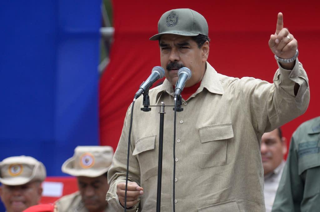 "Venezuelan President Nicolas Maduro has urged his supporters, the military and civilian militias, to defend the leftist ""revolution"" (AFP Photo/Federico Parra)"