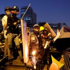 Hong Kong campus protesters fire arrows as anti-government unrest spreads