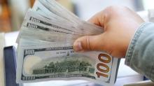 Dollar inches higher after Fed curbs dovish enthusiasm