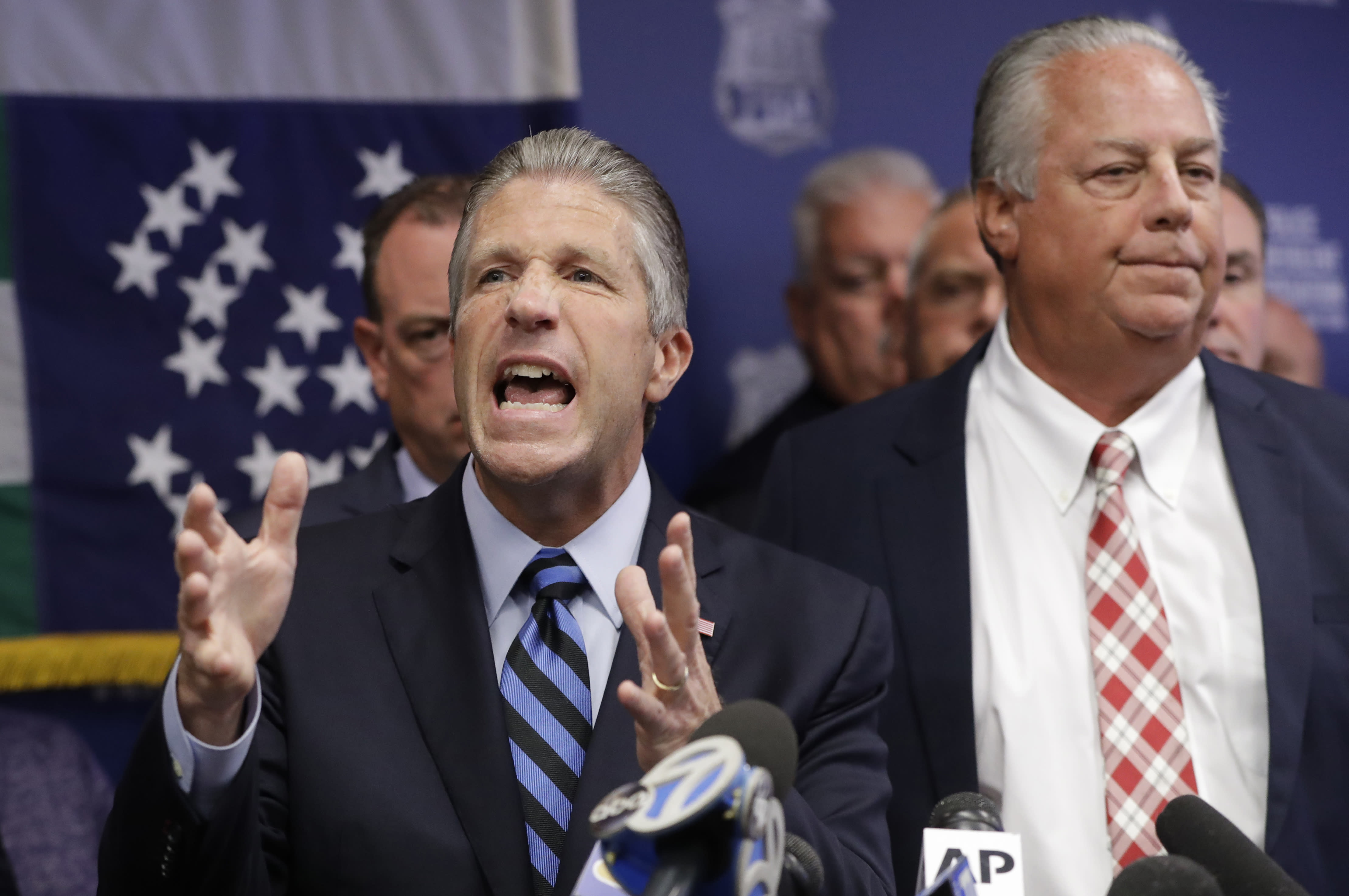 Police Benevolent Associaton President Patrick J. Lynch, left, speaks with NYPD officer Daniel Pantaleo's attorney Stuart London beside him, right, during a press conference at PBA headquarters following a decision to terminate Pantaleo, Monday, Aug. 19, 2019, in New York. Pantaleo was involved in the chokehold death of Eric Garner. T (AP Photo/Kathy Willens)