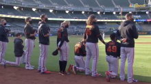 Giants manager Gabe Kapler and four players take knee during national anthem
