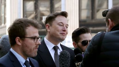 Elon Musk, SEC ask court for another week on deal