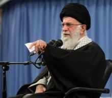 Iran's leaders warn low turnout in election will boost Trump