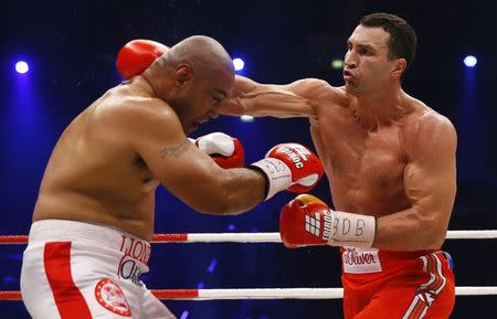 World heavyweight boxing champion Vladimir Klitschko of Ukraine lands a punch to defeat Australian challenger Alex Leapai during their WBO heavyweight title fight in Oberhausen
