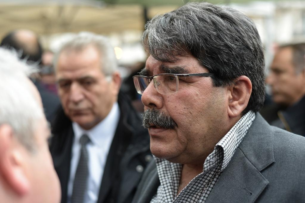 Salih Muslim, chairman of the PYD, arrives on November 17, 2015 to pay tribute to the victims of the Paris attacks