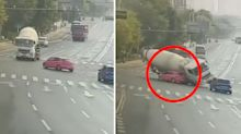 Horrific moment two people crushed to death by cement truck