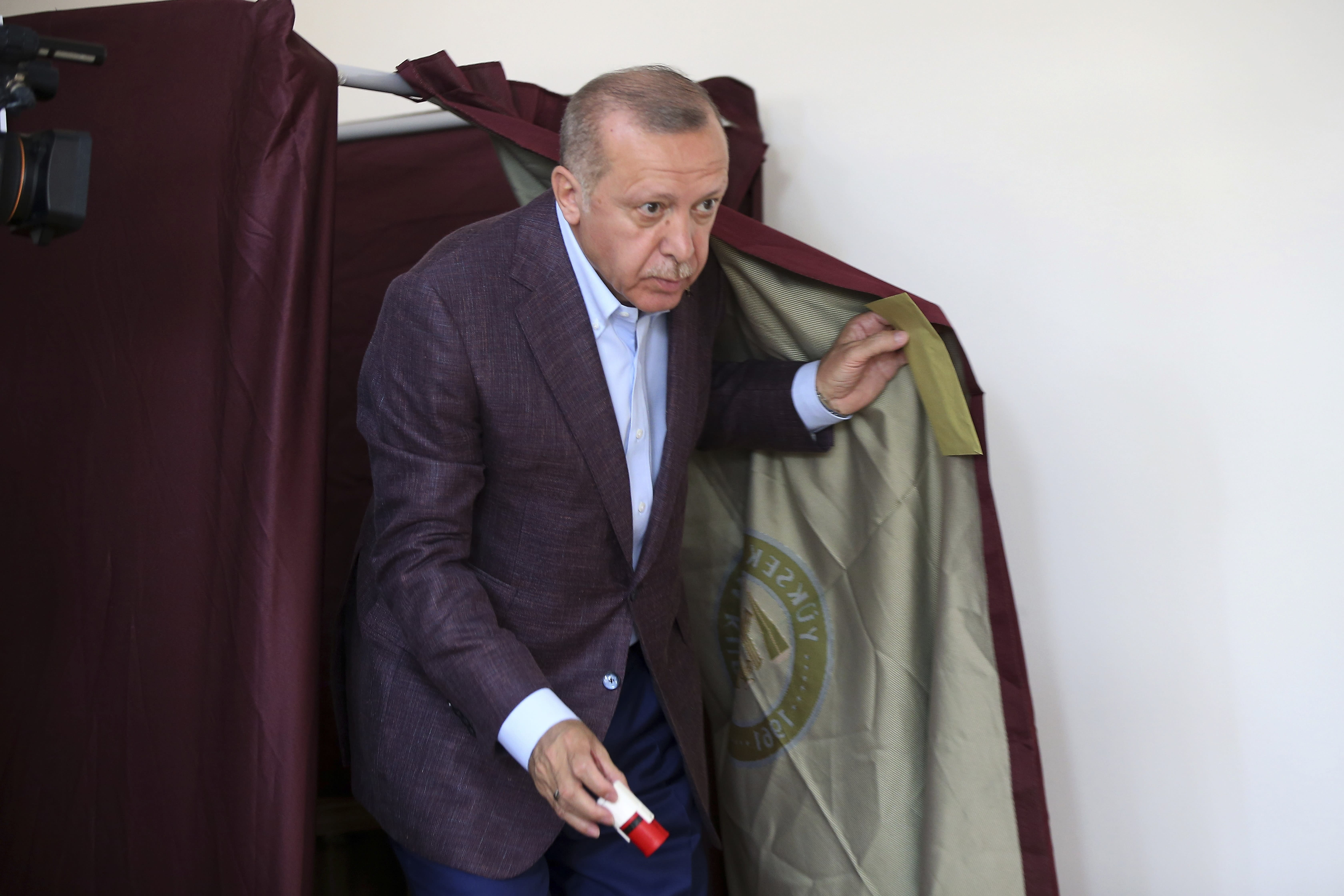 The Latest: Istanbul mayor-elect greets tens of thousands