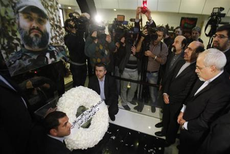 Iran's Foreign Minister Zarif and Iran's Ambassador to Lebanon Roknabadi pay their respect at the grave of assassinated Hezbollah military commander Moughniyeh in the suburbs of Beirut