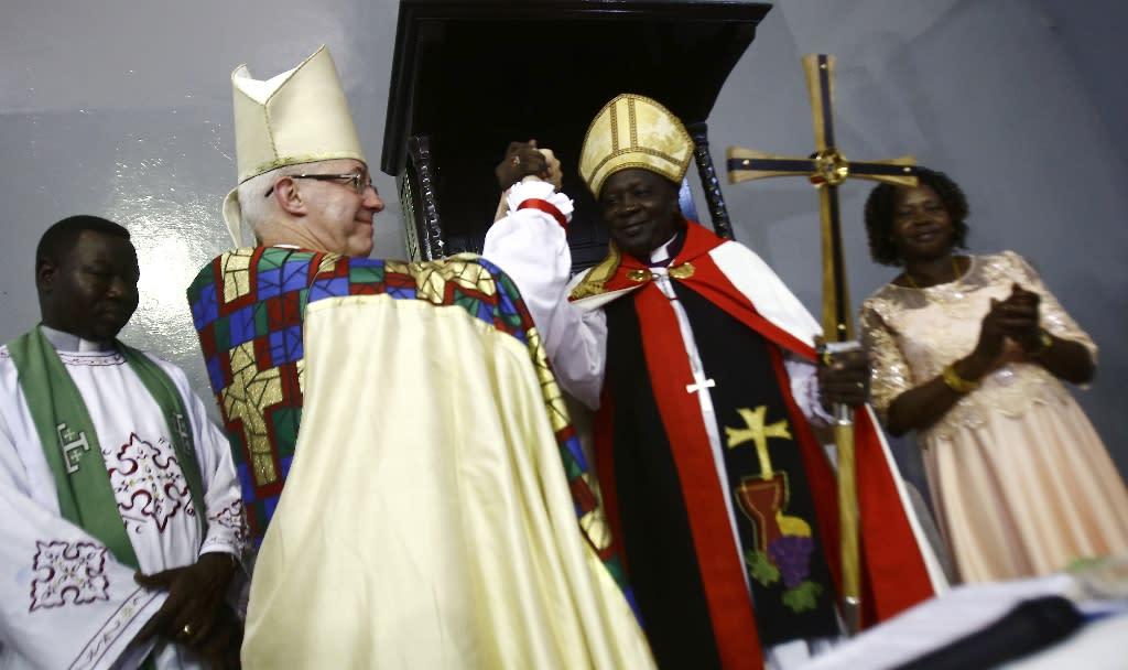 Archbishop of Canterbury Justin Welby and Ezekiel Kondo Kumir Kuku take part in a ceremony installing Kuku as Sudan's first archbishop at Khartoum's All Saints Cathedral on July 30, 2017 (AFP Photo/ASHRAF SHAZLY)