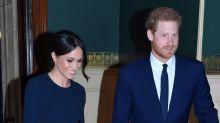 Meghan Markle Wears a Royal-Beloved Cape-Dress