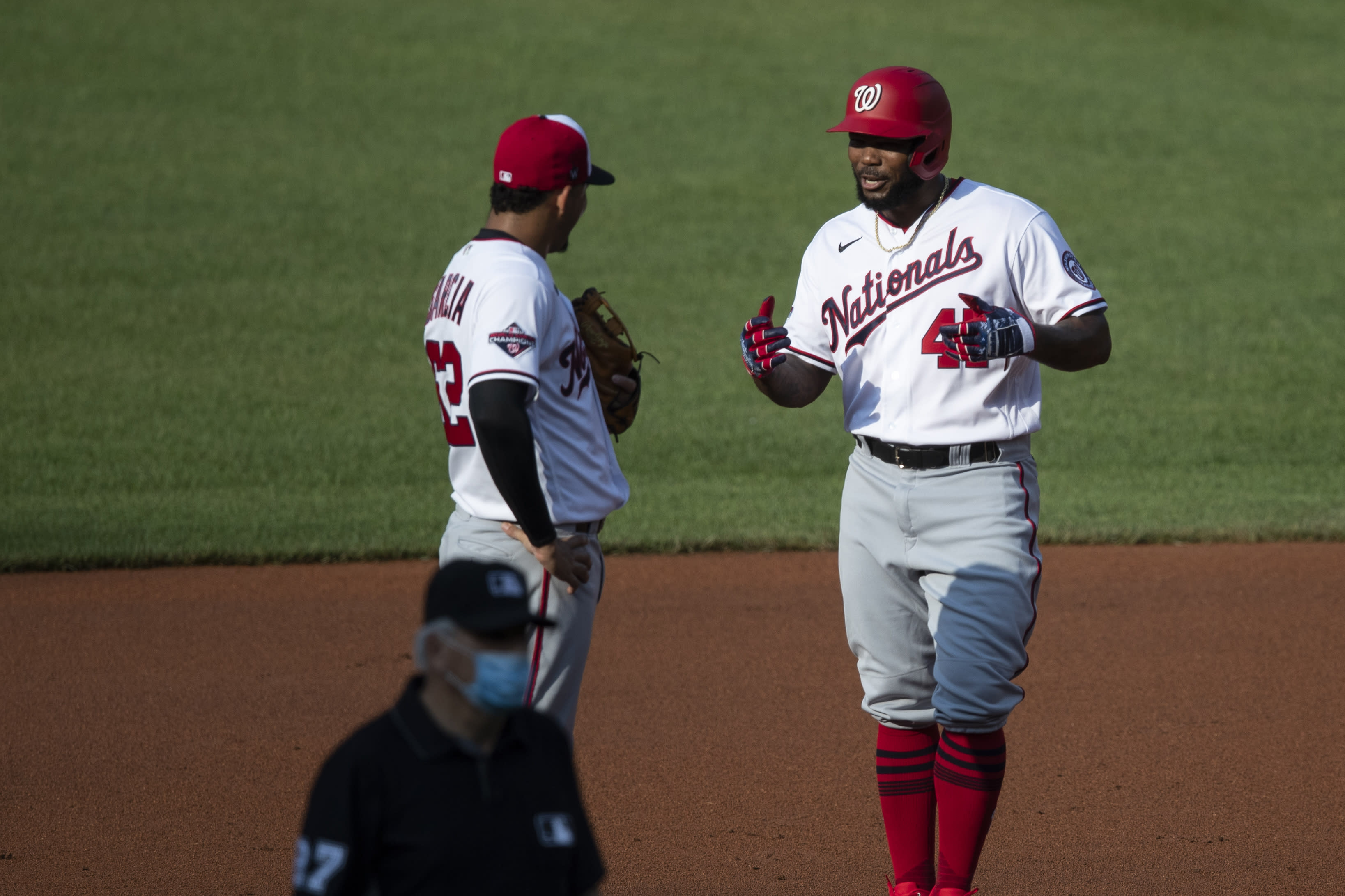 Washington Nationals shortstop Luis Garcia, left, talks with Howie Kendrick as he stands on second base during a baseball intrasquad game at Nationals Park, Thursday, July 16, 2020, in Washington. (AP Photo/Alex Brandon)