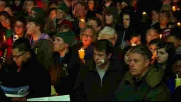 Newtown mourners pray together