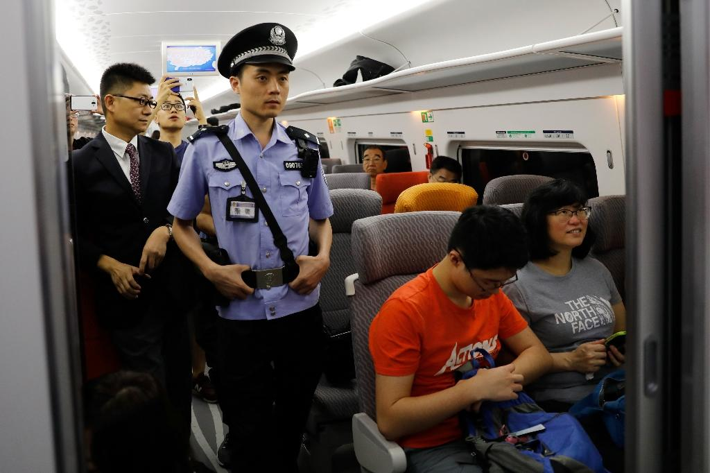 The opening of the rail link sparked criticism as it saw Chinese security stationed on Hong Kong soil for the first time (AFP Photo/TYRONE SIU)