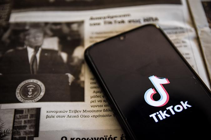 TikTok closeup logo displayed on a smartphone screen and the local newspaper of Chania, Crete Island, Greece on August 3, 2020. President of the USA Donald Trump is threatening and planning to ban the popular video sharing app TikTok from the US because of the security risk. (Photo Illustration by Nikolas Kokovlis/NurPhoto via Getty Images)