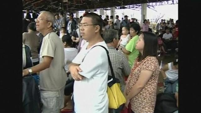 Desperate Filipino residents wait for flights out of typhoon-hit city