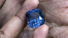 Workmen digging a well in a man's backyard discovered a $100 million windfall - a cluster of 2.5 million sapphire carats