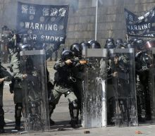 The Latest: Officer hit by arrow in Hong Kong protests