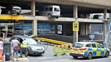 Vehicles left dangling over sheer drop after part of multi-storey car park COLLAPSES