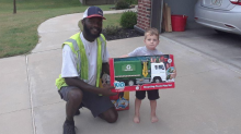 Sanitation worker surprises 3-year-old boy on his route with toy recycling truck