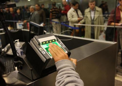 traveler gives fingerprints
