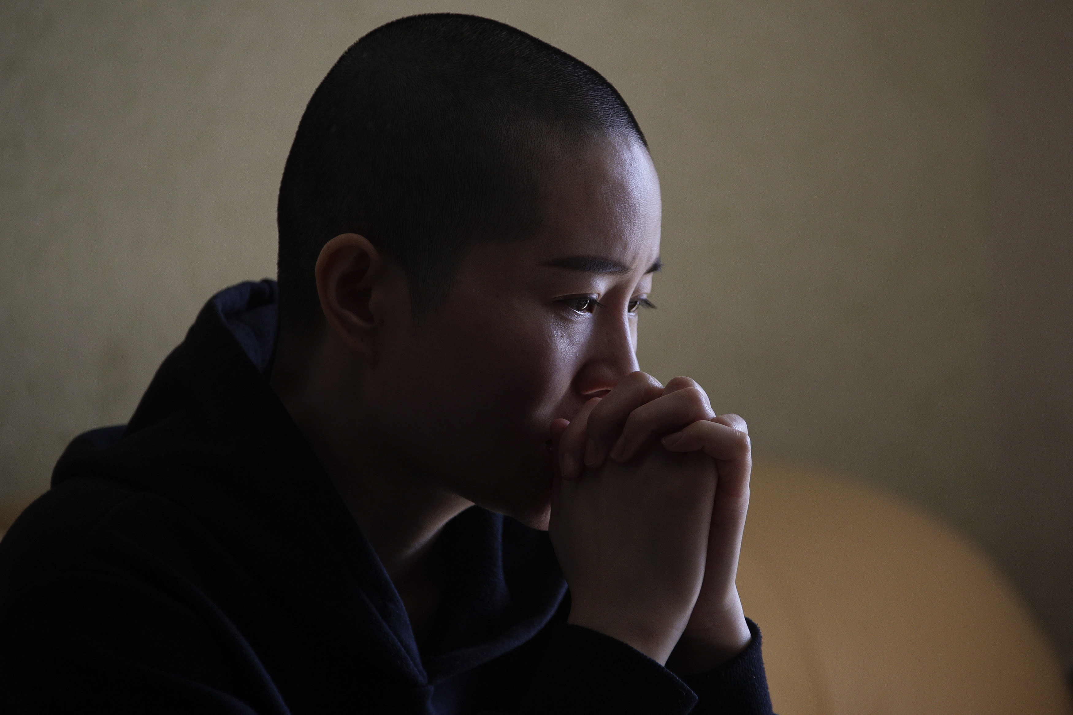 Li Wenzu, wife of prominent Chinese human rights lawyer Wang Quanzhang reacts after Wang's sentencing, at her house in Beijing, Monday, Jan. 28, 2019. Wang was sentenced to 4 and half years in prison on the charge of subversion of state power Monday, more than three years after he was detained in a wide-ranging crackdown on the legal profession. (AP Photo/Andy Wong)
