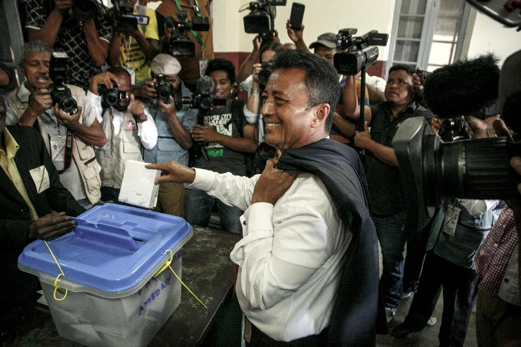 Candidate Marc Ravalomanana (C) and his rival Rajoelina were banned from running in the last election in 2013 under international pressure to avoid a repeat of deadly political violence that engulfed the island in 2009 (AFP Photo/RIJASOLO)