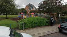 Man arrested after driver stabbed in neck and chest near children's play area