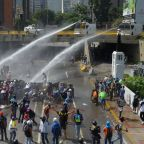 Clashes as Venezuela protesters target military base