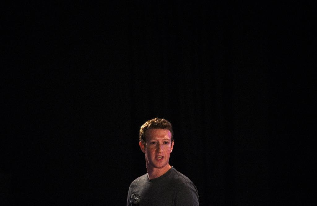 Mark Zuckerberg's apology has done little to quell concerns over personal data misuse at Facebook, which faces probes on both sides of the Atlantic (AFP Photo/MONEY SHARMA)