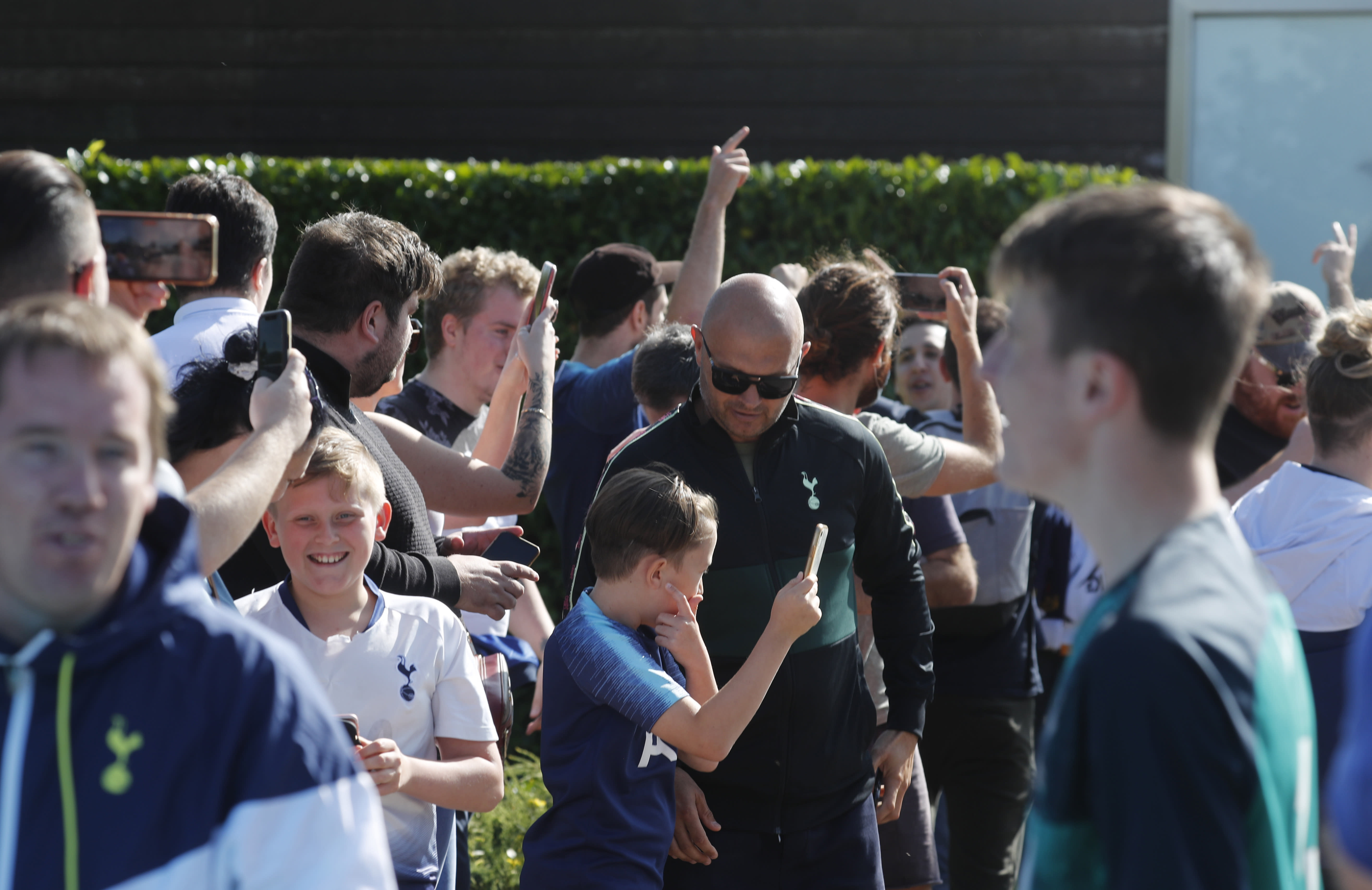 Fans cheers as soccer player Gareth Bale arrives at the training ground of Tottenham Hotspur in London, Friday Sept. 18, 2020. Real Madrid winger Gareth Bale is in London to complete his return to Tottenham. Bale left Tottenham for Madrid in 2013 for 100 million euros. (AP Photo/Frank Augstein)