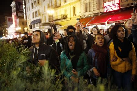 Demonstrators chant against the police during a demonstration against the grand jury decision in the Ferguson, Missouri shooting of Michael Brown in San Francisco, California November 28, 2014. REUTERS/Stephen Lam