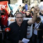 Anger in Barcelona after Spanish police arrest Catalan minister and 12 officials in raids over referendum
