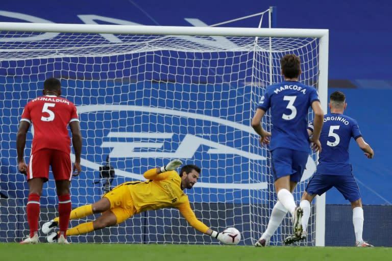 Safe hands: Liverpool's Alisson Becker saved Jorginho's penalty